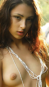 Exotic brunette goes woodsy and gets close to nature exposing her petite breasts and long legs.