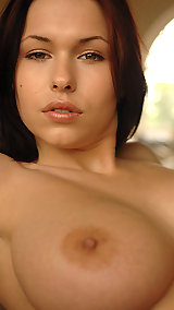 Dark haired beauty exposes her puffy large nipples and breasts both indoors and outdoors.