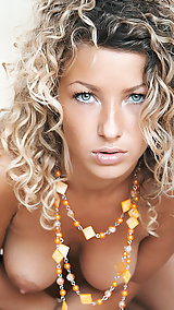 Curly haired blonde gives us a nice spread  if you know what I mean.